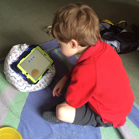 My autistic son playing on his iPad
