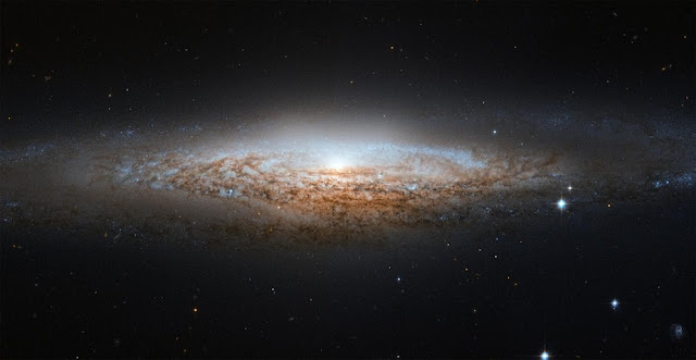 What our Milky Way might look like to alien astronomers: This image of NGC 2683, a spiral galaxy also known as the 'UFO Galaxy' due to its shape, was taken by the Hubble Space Telescope. Since trying to find out what the Milky Way looks like is a bit like trying to picture an unfamiliar house while being confined to a room inside, studies like this one help us gain a better idea of our cosmic home. Credit: ESA/Hubble & NASA