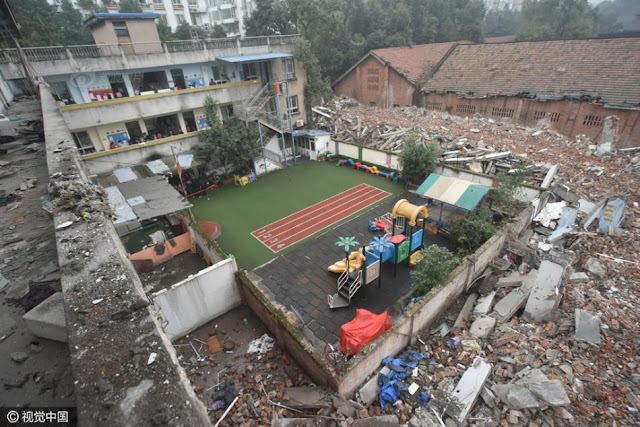 300 kids go to kindergarten surrounded by a sea of rubble