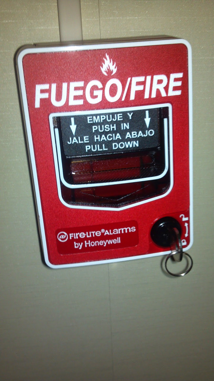fire equipment and fire lite came thru a honeywell fire group company makes pull stations which are bilingual as you can see in the picture below  [ 900 x 1600 Pixel ]