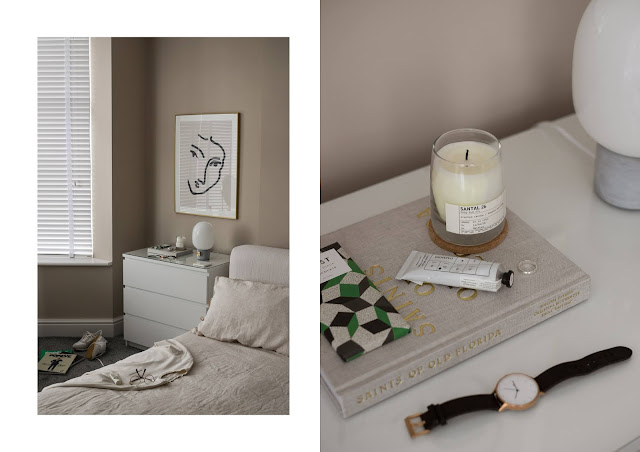 JWDA concrete lamp by menu world, in our tonal bedroom, with linen bedding and candle by le labo