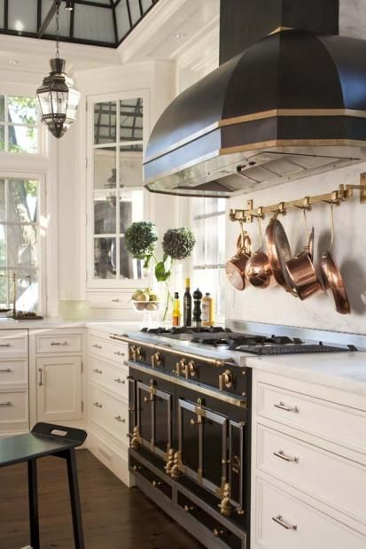 black la corneu stove with iron skyline on the ceiling and white cabinets