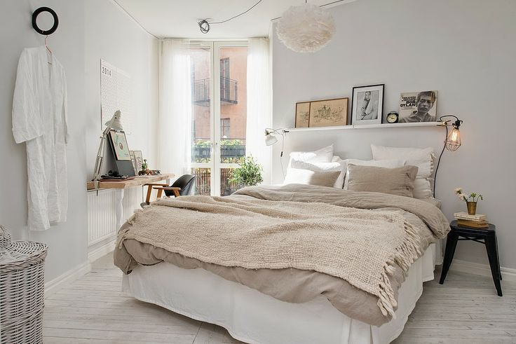 relaxed and cozy scandinavian all white bedroom