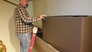 Jim Detweiler installing Allen HR-200 speakers for Swell division