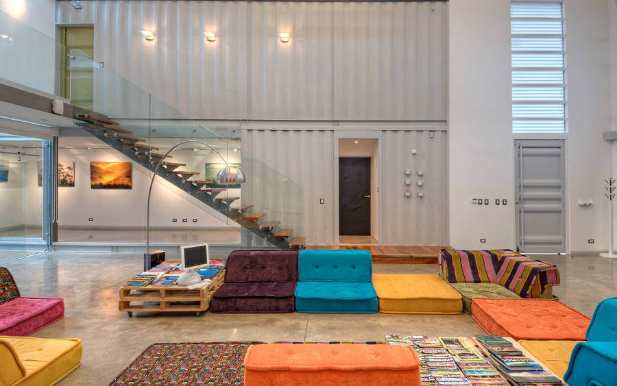 08-Living-Room-and-Stairs-MJ-Trejos-Recycled-Shipping-Containers-Home-www-designstack-co
