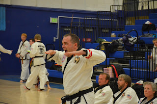Black belt yelling for extra power when doing Taekwondo