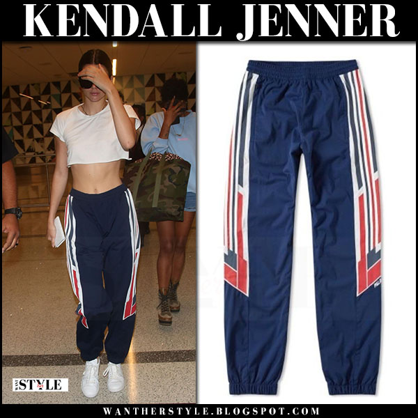 Kendall Jenner in white crop top and blue track pants adidas what she wore july 13 2017 street style