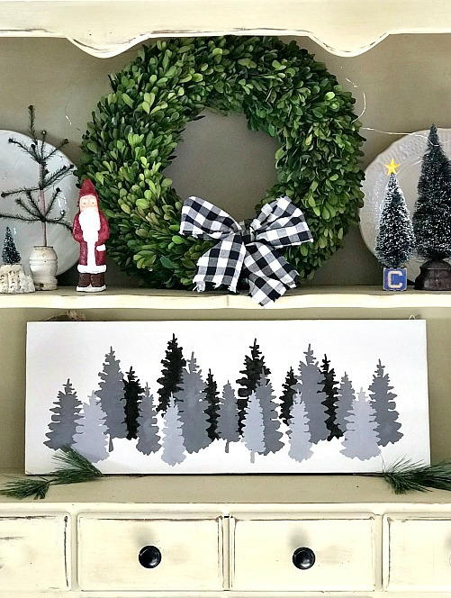 Stenciled shades of grey Christmas tree painting on a hutch. Homeroad.net
