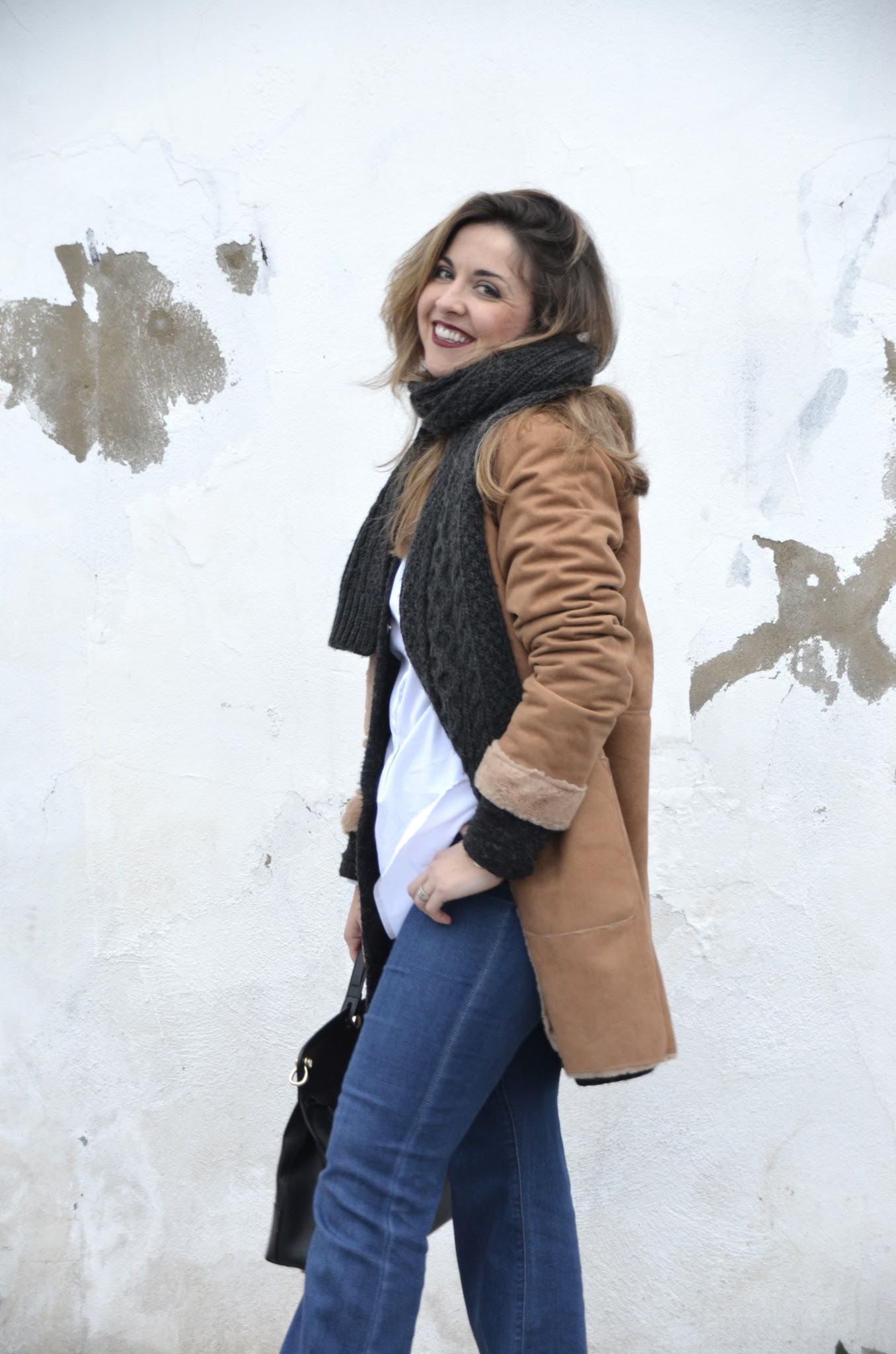 how to wear flared jeans in winter