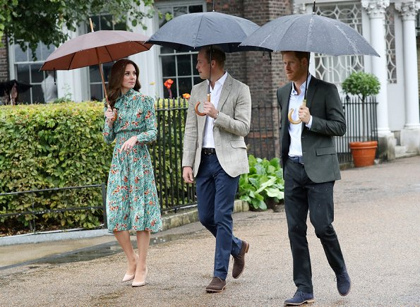 Kate Middleton wore Prada Printed silk dress, Monica Vinader Gold Vermeil Earrings and LK Bennett Fern pumps. Prince Harry