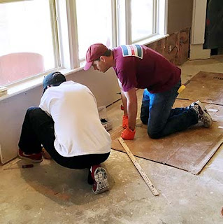 Damaged in flood, coworkers pitch in to help repair Garver engineer's home