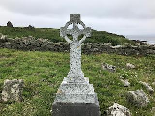 Celtic cross at ruins of an Irish abbey