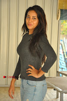 Actress Bhanu Tripathri Pos in Ripped Jeans at Iddari Madhya 18 Movie Pressmeet  0060.JPG