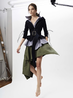 2017 Cruise Collection Monse layered look with dark olive skirt blue button-down shirt and belted black jacket