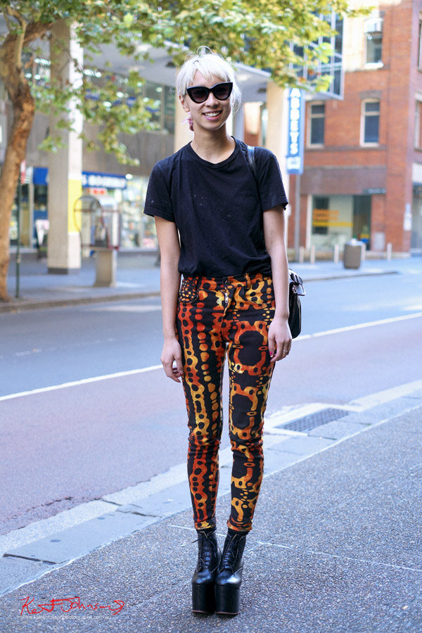 Burnt Orange and black patterned jeans, black Tee and black leather high platform boots with retro sunglasses - Street Fashion Sydney by Kent Johnson - Fuji X-Pro1