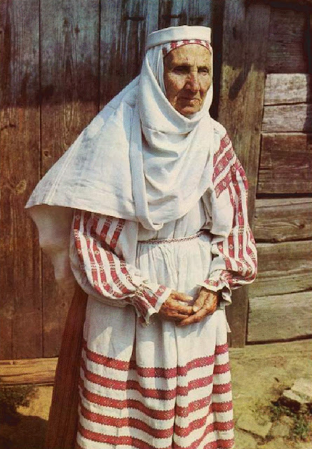 Woman from western polesse region of Belarus wearing traditional namitka headdress