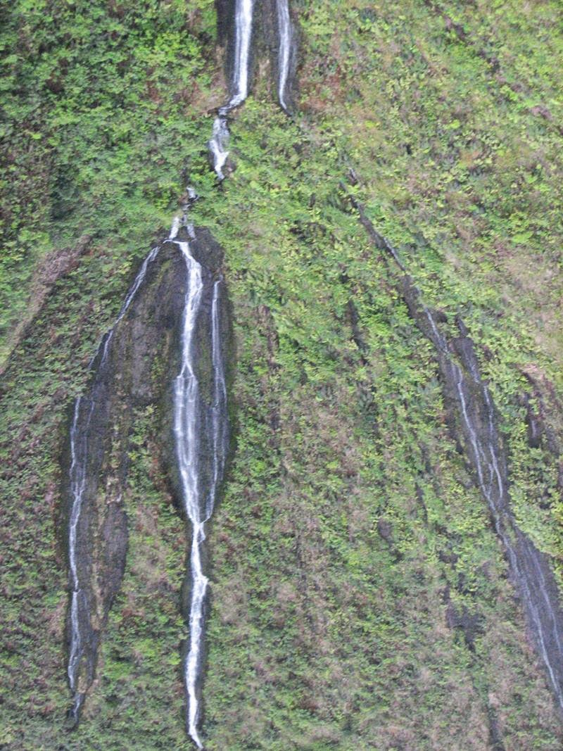 "The mountain Waialeale called ""Wall of Tears"" because on the edges of tropical green mountains."