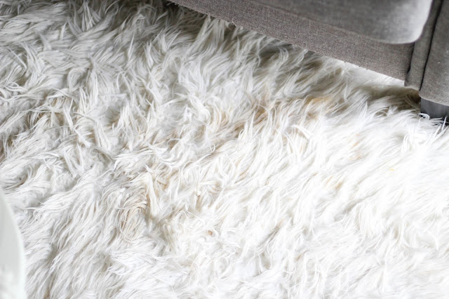 how to clean a white faux fur rug a classy fashionista. Black Bedroom Furniture Sets. Home Design Ideas