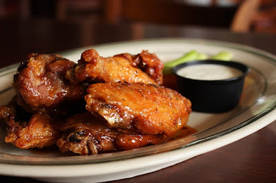 Chicken Wings Deep Fried and Glazed with Hot Sauce