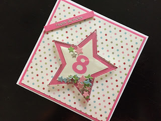 Hand made star shaped shaker card with age 8