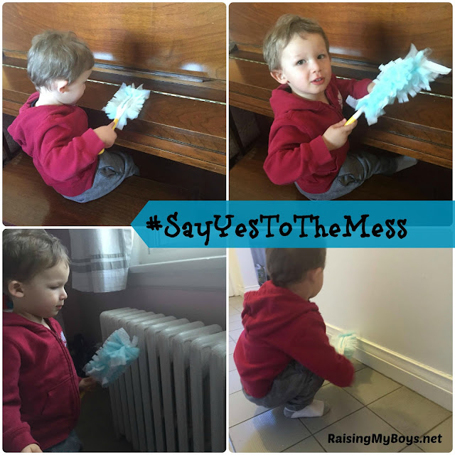 toddler dusting with Swiffer