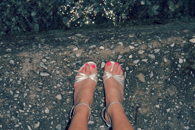 silver sandals and neon coral nails