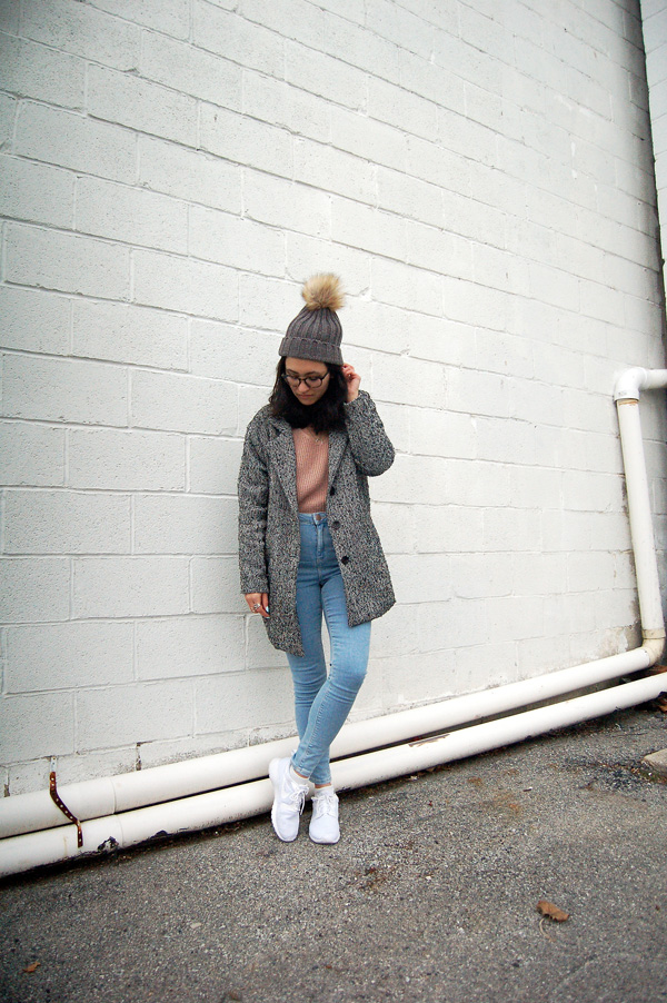 grey coat pink sweater blue jeans white sneakers