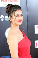 Meenakshi Dixit in Red One Shoulder Red Zipped up gown at IIFA Utsavam Award 19.JPG