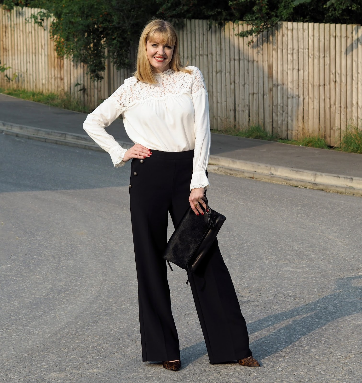 M&S wide legged trousers and romantic lace victoriana blouse with leopard print strappy shoes, over 40 style