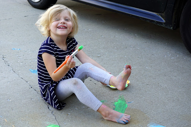 Stella Painting with Sidewalk Chalk