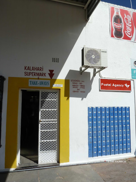 South Africa, Kalahari super market, Northern Cape, Postal Agency, grocery shop, yellow door