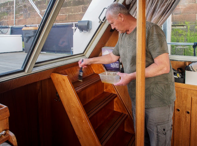Photo of Phil applying the first coat of varnish