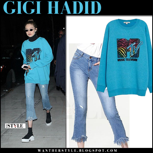 Gigi Hadid in blue MTV sweatshirt marc jacobs, frayed jeans storets and black sneakers what she wore may 2017 streetstyle