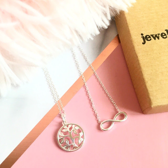 Jewellerybox necklaces - tree of life and infinity, flatlay