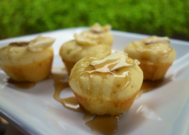Sausage Pancake Muffins - pigs in a blanket muffins. Homemade pancake batter baked in mini muffin pans with a sausage slice in each muffin. So quick and easy. Great weekday breakfast! Serve with additional maple syrup. YUM!