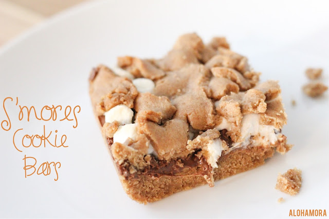S'mores Cookie Bars- simple, unique, homemade dessert.  Just like a s'more, but better b/c it has a cookie bar base.  Delicious. Easy to make. Homemade. Chocolate. Marshmallow. Recipe. Alohamoraopenabook Alohamora Open a Book http://alohamoraopenabook.blogspot.com/