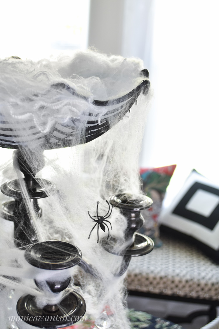 A candelabra with faux spider webs for a centerpiece tutorial.