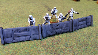 Stormtroopers hide behind the safety of barricades
