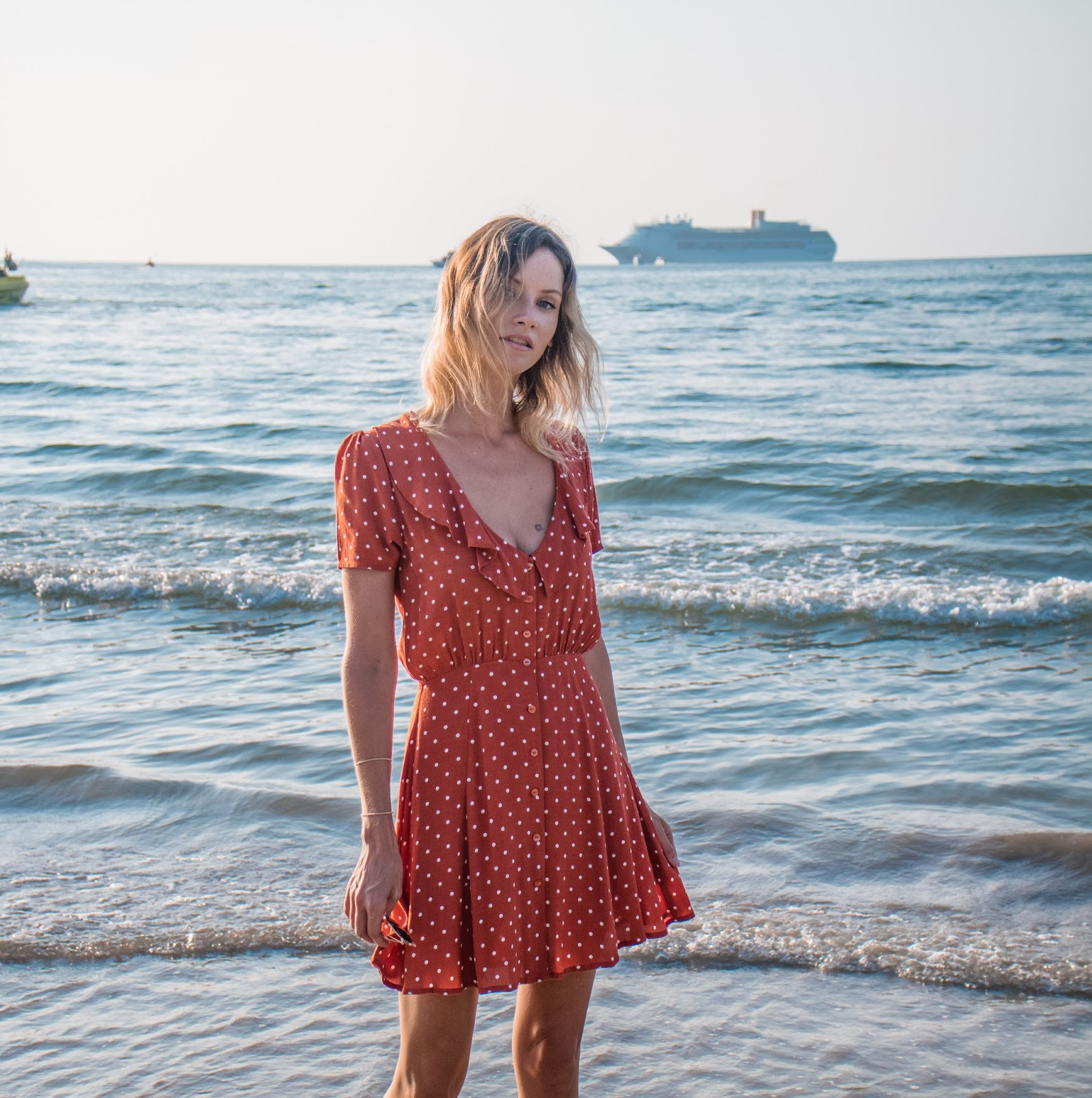 fashion and travel blogger, Alison Hutchinson, is wearing an Auguste dress in Phuket Thailand
