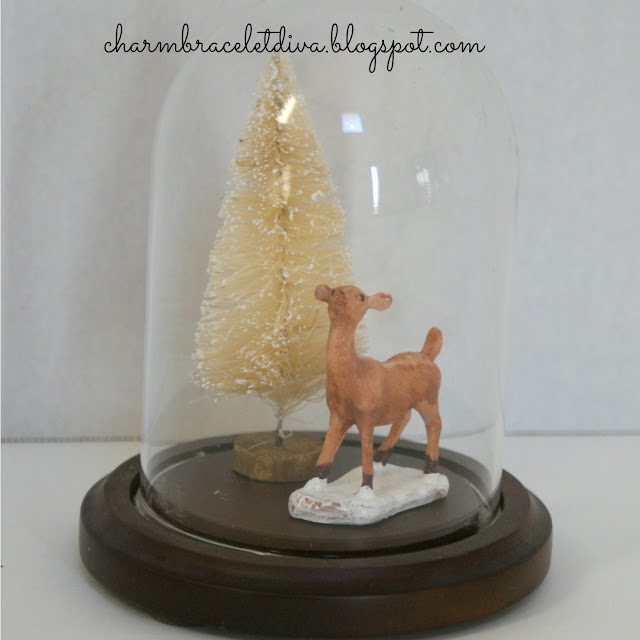 miniature deer in Christmas cloche