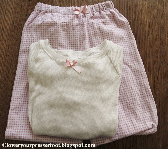 pink check flannelette pyjamas and white knit raglan top