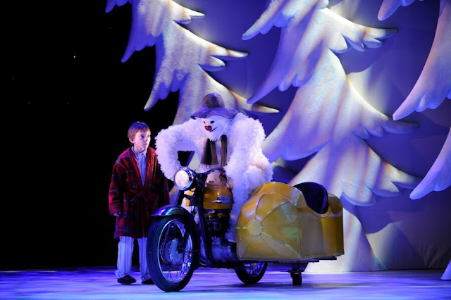 The snowman and the boy riding a bike