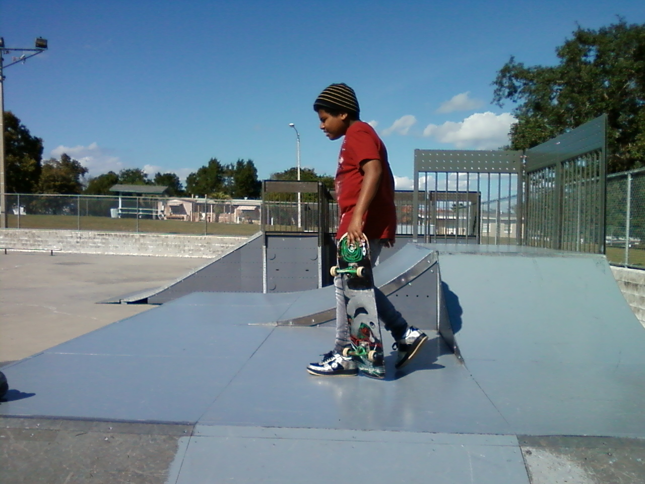 13 year old son skateboarding at the skate park