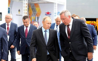 Vladimir Putin with Deputy Prime Minister Dmitry Rogozin at Zvezda shipyard.