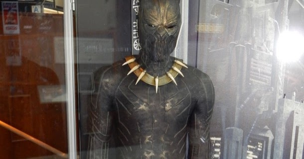 hollywood movie costumes and props black panther 39 s erik killmonger movie costume on display. Black Bedroom Furniture Sets. Home Design Ideas