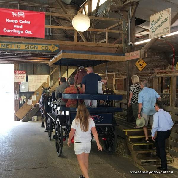 boarding the horse-drawn carriage inside barn at Palmetto Carriage Works in Charleston, South Carolina