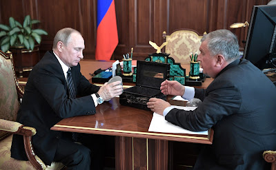 Russian President meeting with Rosneft CEO Igor Sechin.