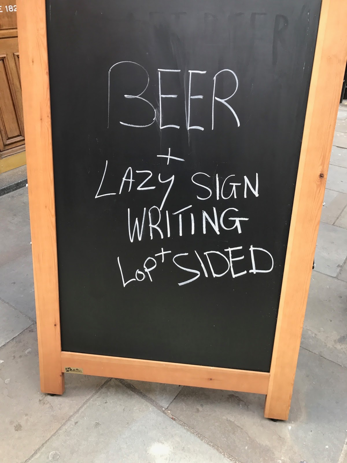 Sign saying Beer and lazy lop sided writing