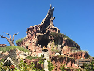 A log falls down Disneyland Splash Mountain