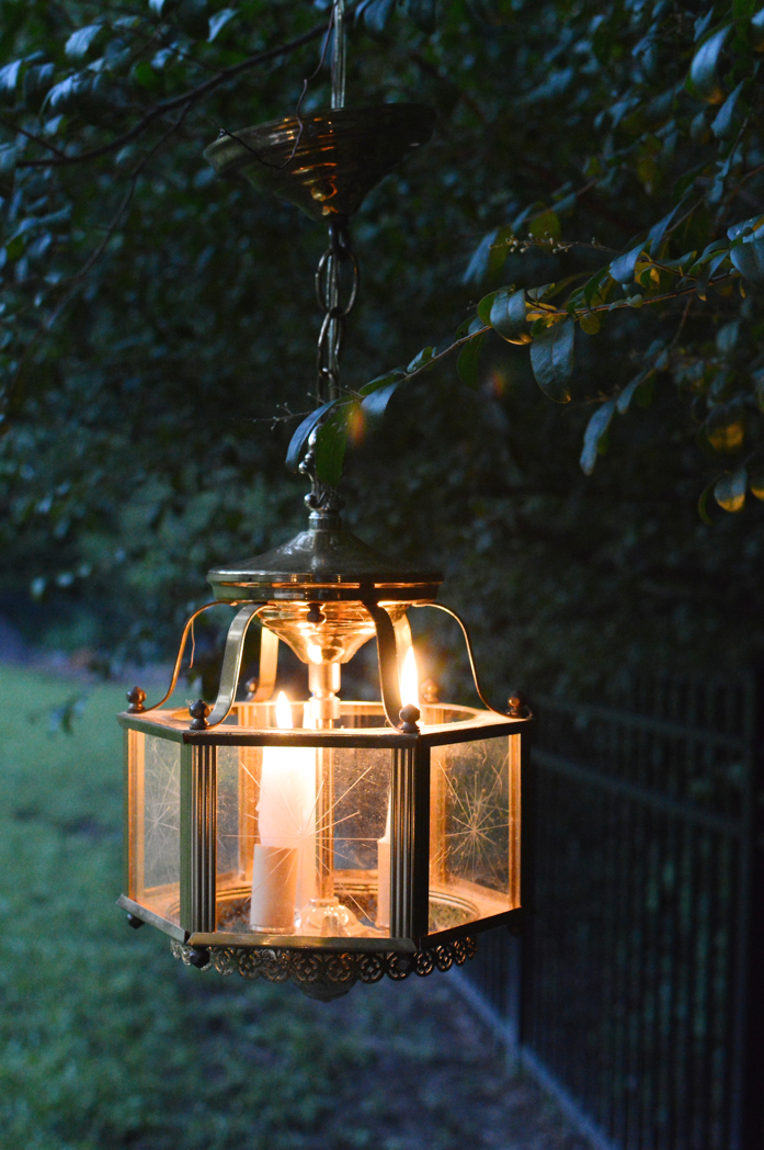 A Repurposed Chandelier Provides Ambient Lighting for Alfresco Dining